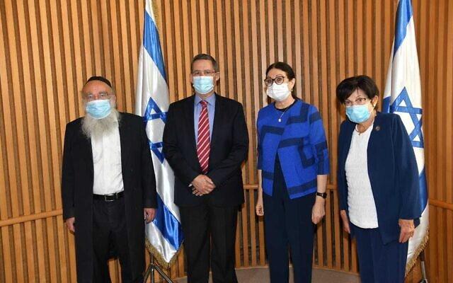 The newly appointed members of the Meron disaster commission: Commission chair and former chief justice Miriam Naor, right, former Bnei Brak mayor Rabbi Mordechai Karelitz, left, former IDF planning chief Maj. Gen. (res.) Shlomo Yanai, 2nd left, and sitting Supreme Court Chief Justice Esther Hayut, 2nd right, who chose the commission members, on June 27, 2021. (Courtesy Courts Authority)