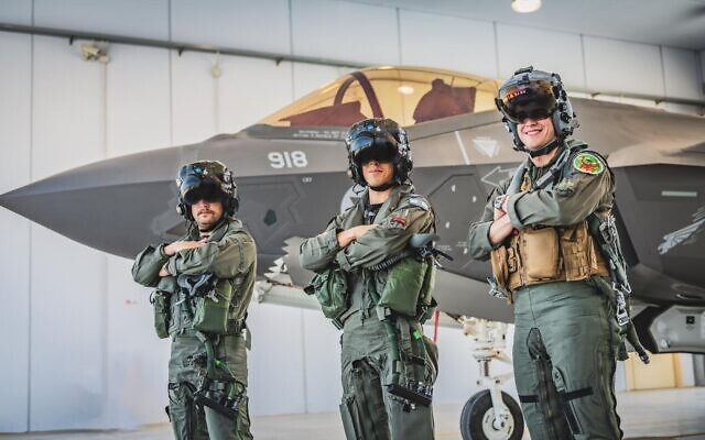 Israeli pilots pose for a photograph in front of an F-35 fighter jet ahead of an air force exercise in Italy in June 2021. (Israel Defense Forces)