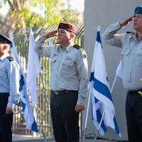 From left, incoming IDF Spokesperson Ran Kochav, head of IDF Operations Aharon Haliva, outgoing IDF Spokesperson Hidai Zilberman salute during a ceremony at the IDF Spokesperson's Unit's headquarters in northern Tel Aviv on June 6, 2021. (Israel Defense Forces)