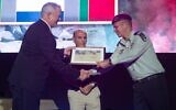 Defense Minister Benny Gantz, left, and former IDF chief of staff Shaul Mofaz, center, award IDF Chief of Staff Aviv Kohavi with the first campaign medal marking Israel's 18-year occupation of southern Lebanon, at a ceremony north of Tel Aviv on June 7, 2021. (Israel Defense Forces)