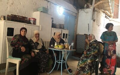Tina (far right), an Arab resident of Acre, with some of her neighbors. She tried to protect the Jewish-owned gallery where she worked during the recent unrest in the mixed city, and is asking how and why this happened in her city (Jessica Steinberg/Times of Israel)