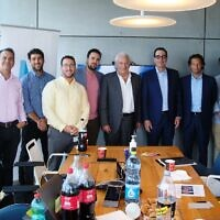 Yaron Carni, fourth from left, David Friedman, center, and Steven Mnuchin, sixth from left, at the offices of Maverick Ventures Israel meeting with local entrepreneurs; June 17, 2021 (Michael Novoselov, Perimiter81)