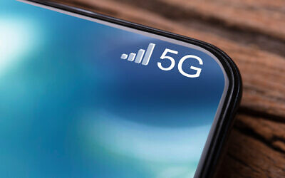 An illustrative image of a mobile phone connected to a 5G Network (AndreyPopov; iStock by Getty Images)