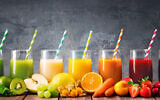 Illustrative image of an assortment of fresh fruits and vegetables juices (AlexRaths; iStock by Getty Images)