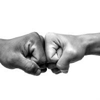 Illustrative image of a fist bump; success (Worawut Prasuwan; iStock by Getty Images)