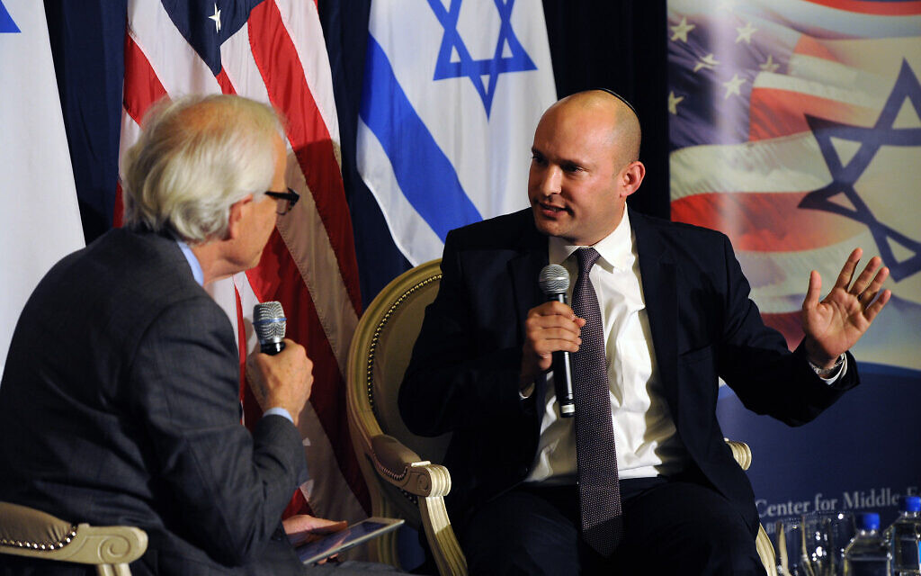 Illustrative: Then-Jewish Home party chairman Naftali Bennett (R) is interviewed by Brookings Executive Vice President Martin Indyk at the Brookings Institute in Washington on December 6, 2014. (Brookings Institute)