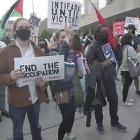 A woman holds a sign that says 'Intifada until victory' at a pro-Palestinian rally held during Israel's Operation Guardian of the Walls, in Nathan Phillips Square, downtown Toronto, May 15, 2021. (Screenshot YouTube)