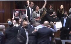 Screen capture from video of MKs holding up potraits of terror victims during a a protest against the confirmation of the new government, June, 13, 2021. (YouTube)