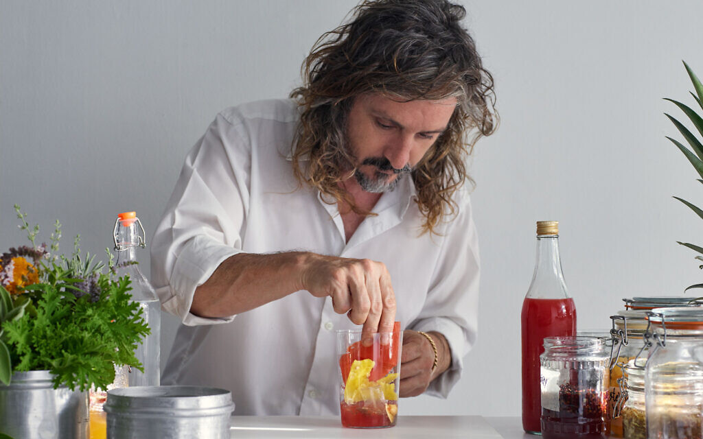 Gazoz master Benny Briga mixes one of his special sparkling water fruit drinks, as featured in 'Gazoz,' by Benny Briga and Adeena Sussman (Artisan Books). Copyright © 2021 (Photographs by Dan Perez)