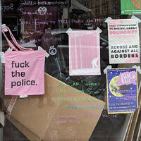 Police confiscated the tote bag here in the display window of The Pink Peacock in Glasgow, Scotland. (Courtesy of The Pink Peacock via JTA)