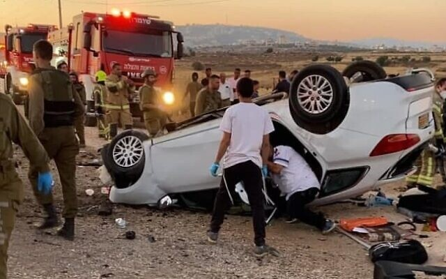 Rescue services work at the scene of a deadly car crash in the West Bank, on June 19, 2021. (Magen David Adom)