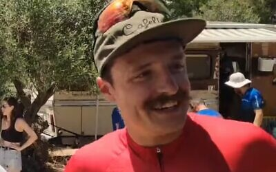 Vlad Logionov after winning the Israel Road Race Championships, on June 19, 2021 (video screenshot)