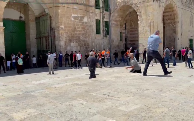 Palestinians and Israel Police officers clash on the Temple Mount in Jerusalem, on June 18, 2021. (Screenshot: Twitter)