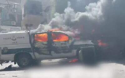 Two police cars are set on fire in the town of Bi'ina in northern Israel amid a clash between residents and officers, on June 19, 2021 (Screenshot/Twitter)