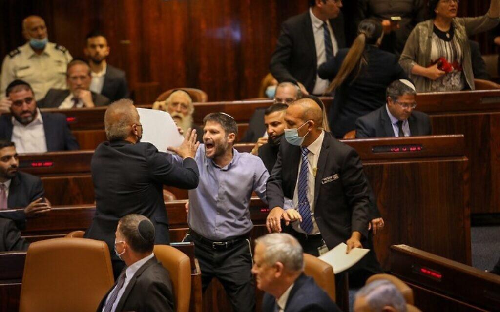 Religious Zionism head Bezalel Smotrich heckles Prime Minister-designate Naftali Bennettat the plenum, June 13, 2021 (Noam Moskowitz/Knesset)