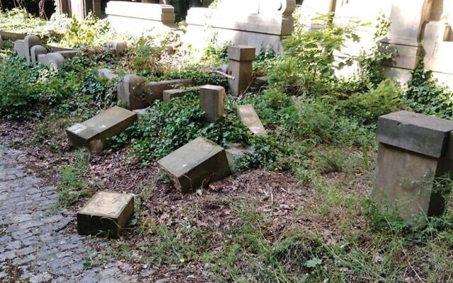 Toppled and smashed headstones lie scattered at the Jewish Cemetery of Wroclaw, Poland, June 16, 2021. (The Jewish Community of Wroclaw via JTA)
