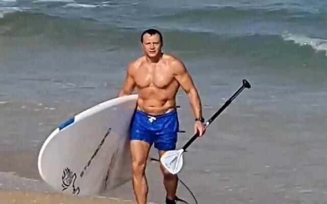 Tourism Minister Yoel Razvozov at the beach, June 19, 2021 (video screen grab)