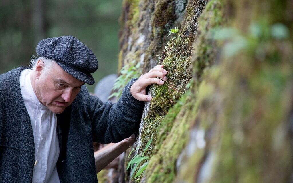 Director, actor and author of the theatre group Teatro Caprile, Andreas Kosek reenacts an emigration scene on the old Roman road in the Krimmler Tauern Alps on the border between Austria and Italy, near Krimml, on June 25, 2021. (ALEX HALADA/AFP)