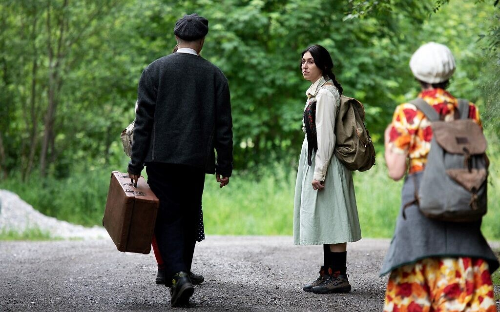 Actors of the theatre group Teatro Caprile reenact an emigration scene on an old Roman road in the Krimmler Tauern Alps on the border between Austria and Italy in Krimml, on June 25, 2021. (ALEX HALADA/AFP)