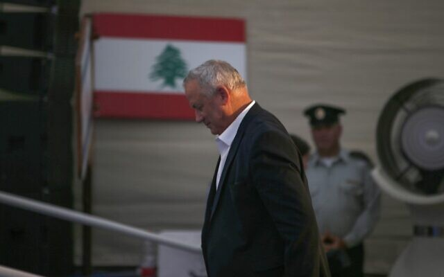 Defense Minister Benny Gantz takes part in a ceremony in the northern town of Metula on July 4, 2021, to inaugurate a monument commemorating fallen members of the South Lebanon Army. (Jalaa Marey/AFP)
