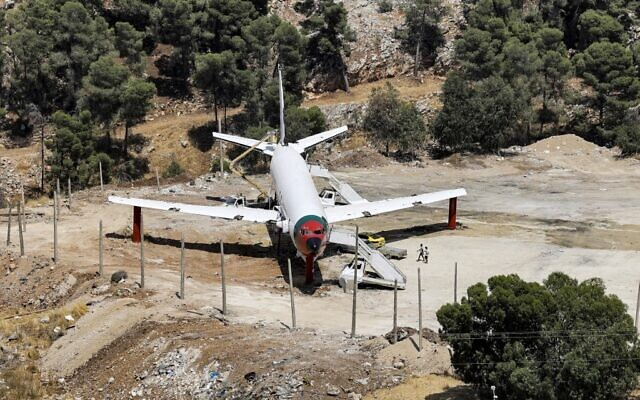The fuselage of a Boeing 707 aircraft being converted by Palestinian twin brothers Atallah and Khamis al-Sairafi into a restaurant near the city of Nablus in the West Bank on July 5, 2021. (Photo by JAAFAR ASHTIYEH / AFP)
