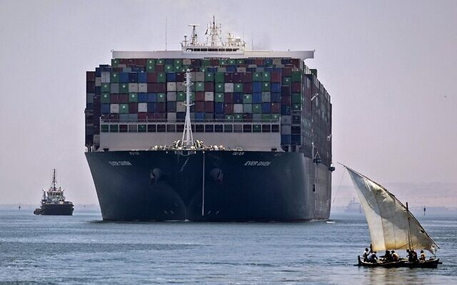 The Panama-flagged MV 'Ever Given' container ship sails near a felucca along Egypt's Suez Canal near the canal's central city of Ismailia, July 7, 2021. (Mahmoud KHALED / AFP)