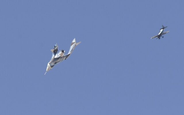 The Virgin Galactic SpaceShipTwo space plane Unity and mothership separate as they fly way above Spaceport America, near Truth and Consequences, New Mexico on July 11, 2021 on the way to the cosmos. (Patrick T. FALLON / AFP)