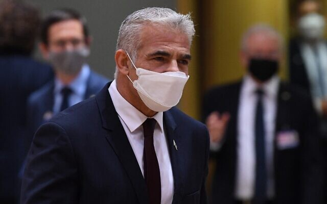 Israeli Foreign Minister Yair Lapid arrives for a Foreign Affairs Council meeting at the EU headquarters in Brussels on July 12, 2021. (JOHN THYS / AFP)