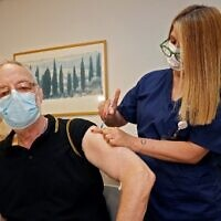 A man receives a third dose of the Pfizer-BioNTech COVID-19 coronavirus vaccine at the outpatient clinics of the Cardiovascular Centre at Sheba Medical Center near Tel Aviv, Israel, on July 12, 2021. (Jack Guez/AFP)
