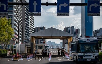 A general view shows one of the entrances of the Olympic and Paralympic Village in Tokyo on July 15, 2021, ahead of the 2020 Tokyo Olympic Games which begins on July 23. (Philip FONG / AFP)