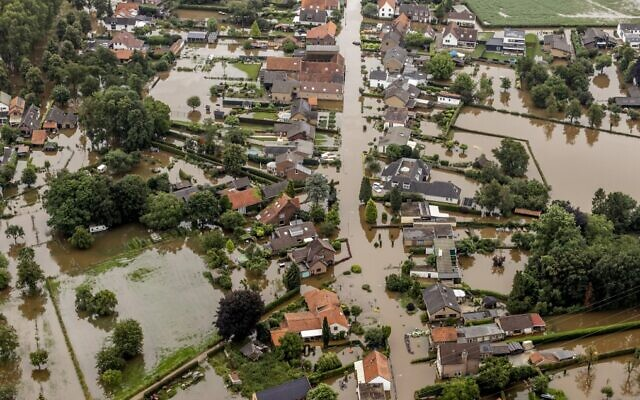 This aerial view taken in Brommelen, Netherlands, shows the flooded area around the Meuse after a levee of the Juliana Canal broke, July 16, 2021. (Remko de Waal/ANP/AFP)