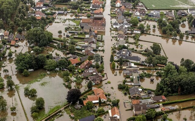 This aerial view taken in Brommelen on July 16, 2021 shows the flooded area around the Meuse after a levee of the Juliana Canal broke  (Remko de Waal / ANP / AFP)