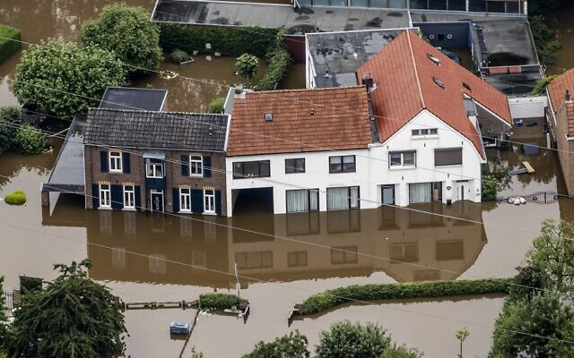 This aerial view taken in Valkenburg on July 16, 2021 shows the flooded area around the Meuse (Remko de Waal / ANP / AFP)