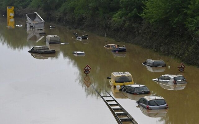 Submerged cars and other vehicles are seen on the federal highway B265 in Erftstadt, western Germany, on July 17, 2021 after heavy rains hit parts of the country, causing widespread flooding and major damage. (Photo by SEBASTIEN BOZON / AFP)