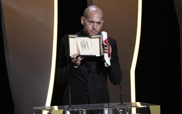 """Israeli director Nadav Lapid give a speech after he was awarded with the Jury Prize for the film """"Ha'Berech"""" during the closing ceremony of the Cannes Film Festival in Cannes, France, on July 17, 2021. (Christophe Simon/AFP)"""