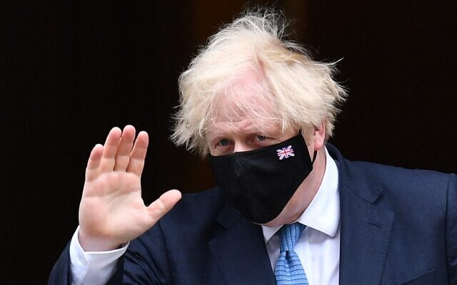 UK Prime Minister Boris Johnson leaves 10 Downing Street in London, on July 14, 2021. (Justin Tallis/AFP)