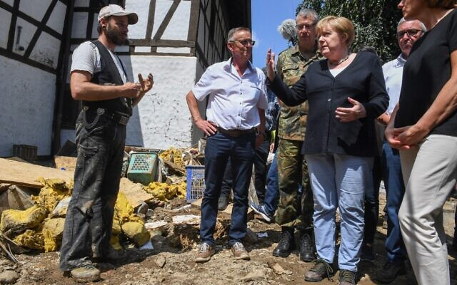 German Chancellor Angela Merkel (3rd-R) visits the flood-ravaged village of Schuld near Bad Neuenahr-Ahrweiler, Rhineland-Palatinate state, western Germany, on July 18, 2021. (Christof Stache/Pool/AFP)