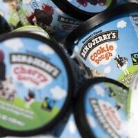 In this file photo taken on May 19, 2021 Ben and Jerry's ice cream is stored in a cooler at an event where founders Jerry Greenfield and Ben Cohen gave away ice cream to bring attention to police reform at the US Supreme Court in Washington, DC. (Photo by Kevin Dietsch / GETTY IMAGES NORTH AMERICA / AFP)
