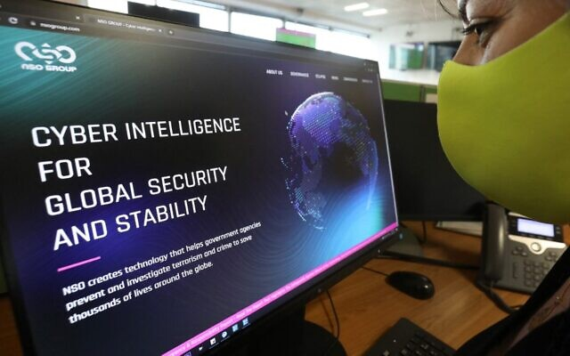 A woman checks the website of Israel-made Pegasus spyware at an office in the Cypriot capital Nicosia on July 21, 2021. (Mario Goldman/AFP)