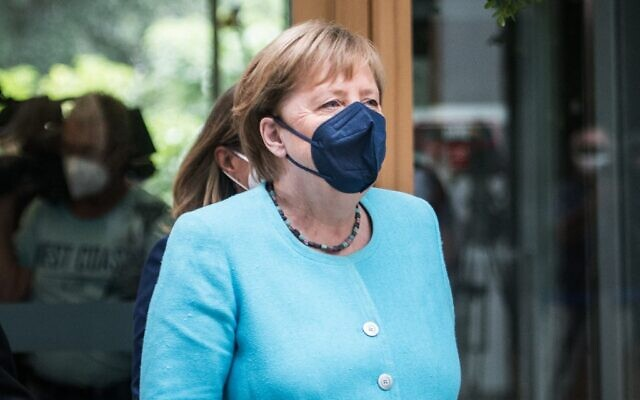 German Chancellor Angela Merkel wears a face mask as she arrives at the house of the Federal Press Conference, on July 22, 2021, in Berlin. (Stefanie Loos/AFP)