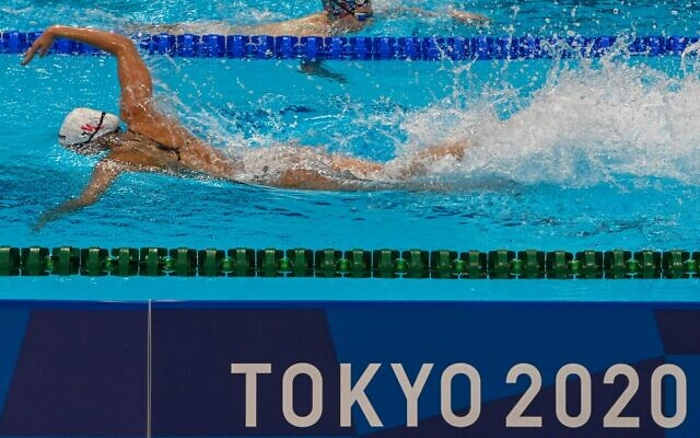 Athletes take part in a swimming training session at the Tokyo Aquatics Centre in Tokyo on July 23, 2021, ahead of the Tokyo 2020 Olympic Games. (Attila KISBENEDEK / AFP)