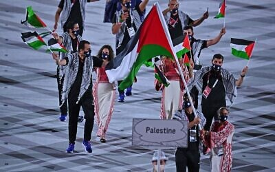 Palestine's flag bearer Dania Nour and their delegation parade during the opening ceremony of the Tokyo 2020 Olympic Games, at the Olympic Stadium, in Tokyo, on July 23, 2021. (Ben STANSALL / AFP)