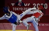 Israel's Abishag Semberg (blue) and Puerto Rico's Victoria Stambaugh (red) compete in the taekwondo women's -49kg elimination round bout during the Tokyo 2020 Olympic Games at the Makuhari Messe Hall in Tokyo on July 24, 2021. (Javier SORIANO / AFP)