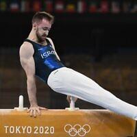 Israel's Artem Dolgopyat competes in the pommel horse event of the artistic gymnastics men's qualification during the Tokyo 2020 Olympic Games at the Ariake Gymnastics Centre in Tokyo on July 24, 2021. (Photo by Lionel BONAVENTURE / AFP)