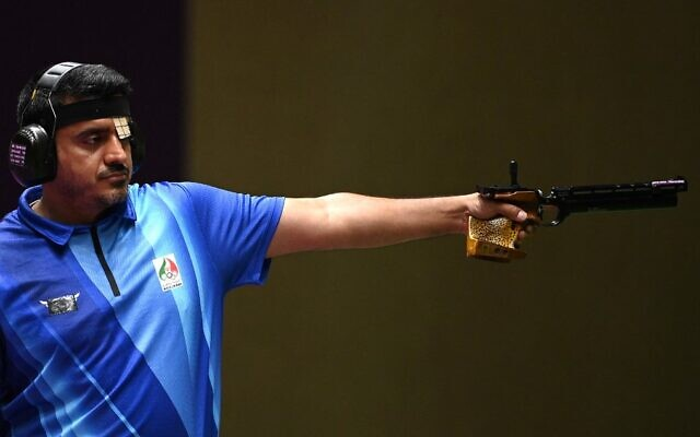 Iran's Javad Foroughi competes in the men's 10m air pistol final during the Tokyo 2020 Olympic Games at the Asaka Shooting Range in the Nerima district of Tokyo on July 24, 2021. (Tauseef Mustafa/AFP)