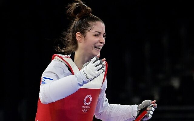 Israel's Abishag Semberg celebrates winning the taekwondo women's -49kg bronze medal A bout during the Tokyo 2020 Olympic Games at the Makuhari Messe Hall in Tokyo on July 24, 2021. (Javier SORIANO / AFP)