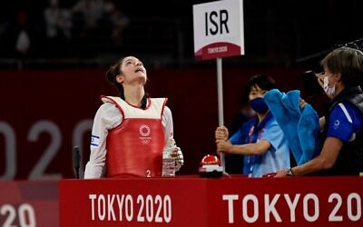 Israel's Abishag Semberg celebrates wining the taekwondo women's -49kg bronze medal A bout during the Tokyo 2020 Olympic Games at the Makuhari Messe Hall in Tokyo, on July 24, 2021. (Javier Soriano/AFP)