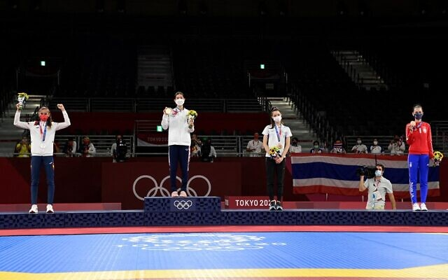 From left to right: Spain's Adriana Cerezo Iglesias (silver), Thailand's Panipak Wongpattanakit (gold) and Israel's Avishag Semberg (bronze) and Serbia's Tijana Bogdanovic (bronze) pose on the podium after the taekwondo women's -49kg bouts during the Tokyo 2020 Olympic Games at the Makuhari Messe Hall in Tokyo, on July 24, 2021. (Javier Soriano/AFP)