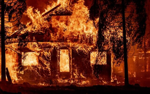 A home burns as flames from the Dixie fire tear through the Indian Falls neighborhood of unincorporated Plumas County, California on July 24, 2021. (JOSH EDELSON / AFP)