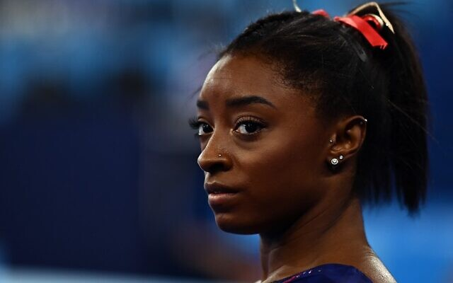 USA's Simone Biles gets ready to compete in the uneven bars event of the  artistic gymnastics women's qualification during the Tokyo 2020 Olympic Games at the Ariake Gymnastics Centre in Tokyo on July 25, 2021. (Loic VENANCE / AFP)